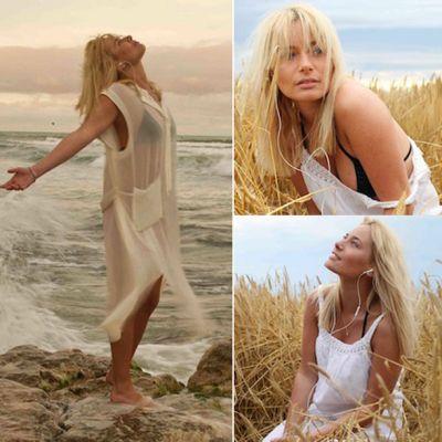 Laura Cosoi, intr-o rochie trasparenta, la malul marii. Vezi o sedinta foto super sexy