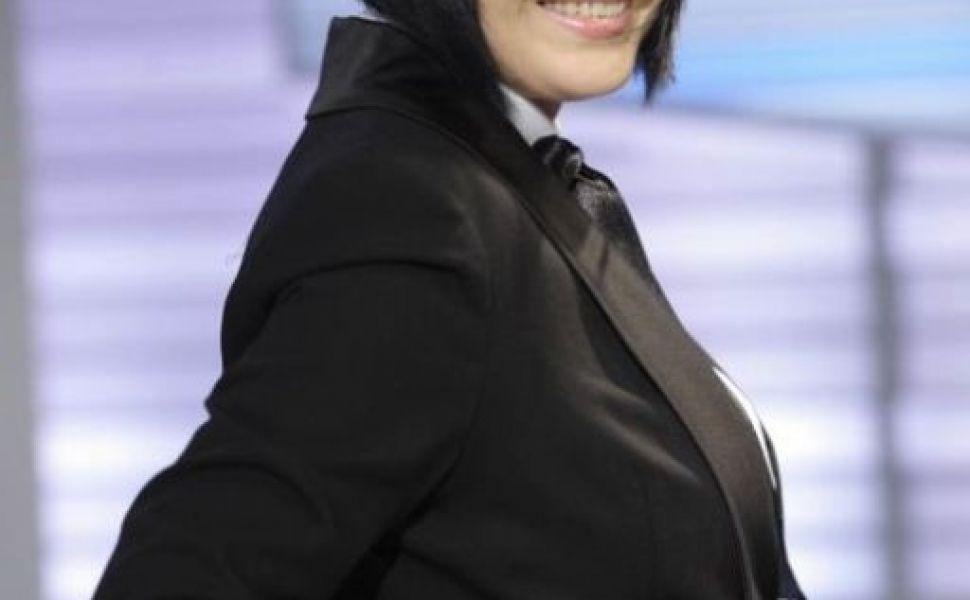 O vezi zilnic la televizor. Uite cum arata Neti Sandu in urma cu 12 de ani in costum de baie